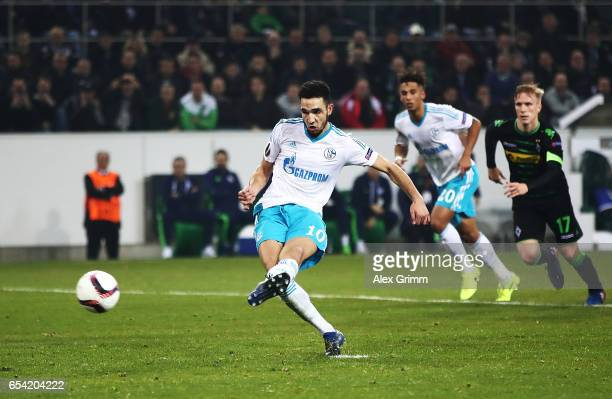 Nabil Bentaleb of Schalke 04 scores a penalty goal during the UEFA Europa League Round of 16 second leg match between Borussia Moenchengladbach and...