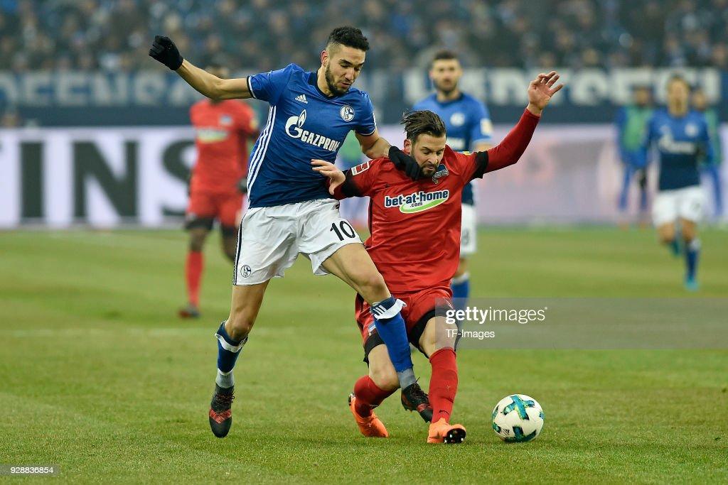 Nabil Bentaleb of Schalke and Marvin Plattenhardt of Hertha battle for the ball during the Bundesliga match between FC Schalke 04 and Hertha BSC at Veltins-Arena on March 03, 2018 in Gelsenkirchen, Germany.