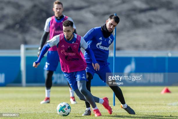 Nabil Bentaleb of Schalke and Pablo Insua of Schalke battle for the ball during a training session at the FC Schalke 04 Training center on March 26...
