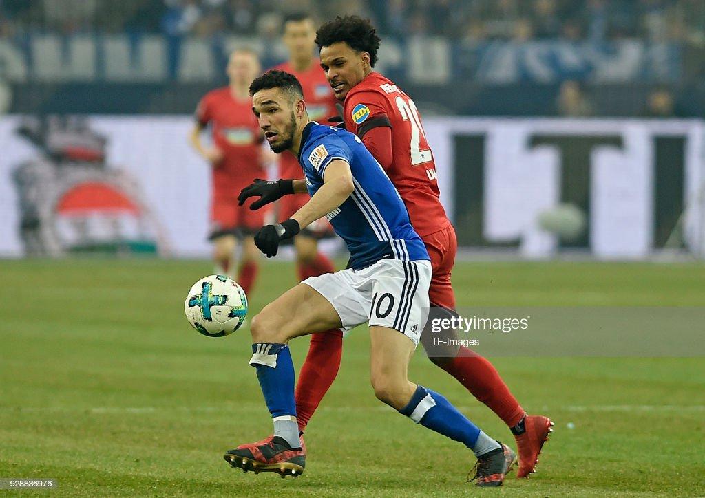 Nabil Bentaleb of Schalke and Valentino Lazaro of Hertha battle for the ball during the Bundesliga match between FC Schalke 04 and Hertha BSC at Veltins-Arena on March 03, 2018 in Gelsenkirchen, Germany.