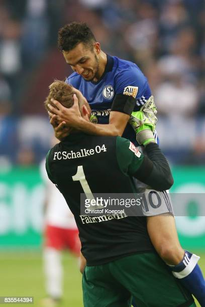 Nabil Bentaleb of Schalke celebrate with Ralf Faehrmann of Schalke after he scored to make it 10 during the Bundesliga match between FC Schalke 04...