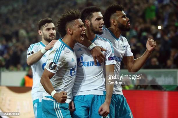 Nabil Bentaleb of Schalke celebrates his team's second goal with team mate Eric Maxim ChoupoMoting Thilo Kehrer and Daniel Caligiuri during the UEFA...