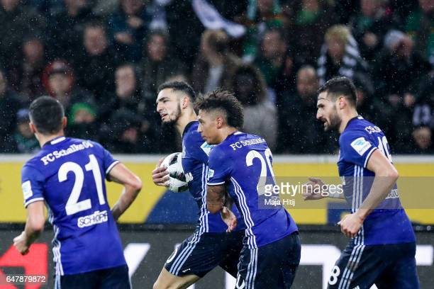 Nabil Bentaleb of Schalke celebrates with his teammates after scoring his team's first goal to make it 11 during the Bundesliga match between...
