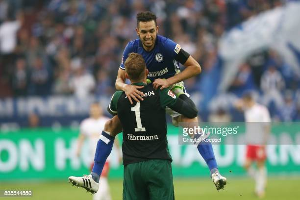 Nabil Bentaleb of Schalke celebrates with Ralf Faehrmann of Schalke after he scored to make it 10 during the Bundesliga match between FC Schalke 04...