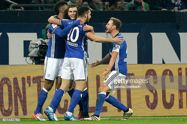 Nabil Bentaleb of Schalke celebrates with team mates after scoring his team's second goal during the Bundesliga match between FC Schalke 04 and...