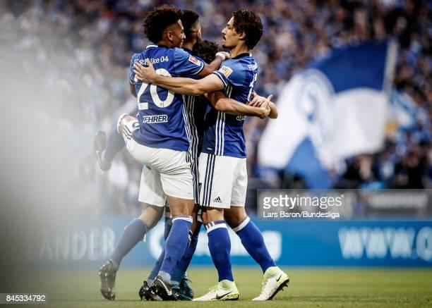 Nabil Bentaleb of Schalke celebrates with team mates after scoring his teams first goal during the Bundesliga match between FC Schalke 04 and VfB...