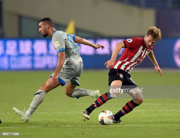 Nabil Bentaleb of Schalke competes with Stuart Armstrong of Southampton FC during the 2018 Clubs Super Cup match between FC Schalke 04 and...