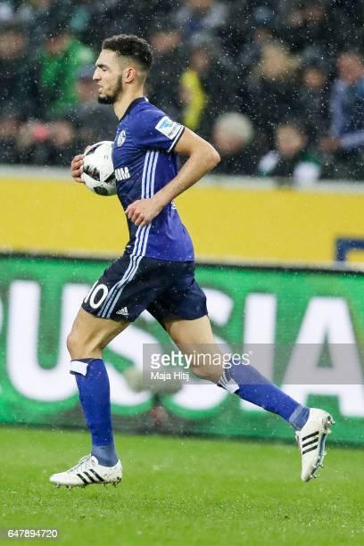 Nabil Bentaleb of Schalke holds the ball after scoring 11meter penalty shot to make it 11 during the Bundesliga match between Borussia...
