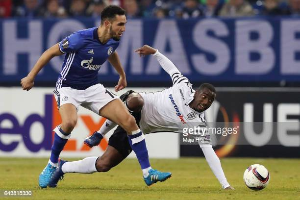 Nabil Bentaleb of Schalke is challenged by Djalma Campos of PAOK during the UEFA Europa League Round of 32 second leg match between FC Schalke 04 and...