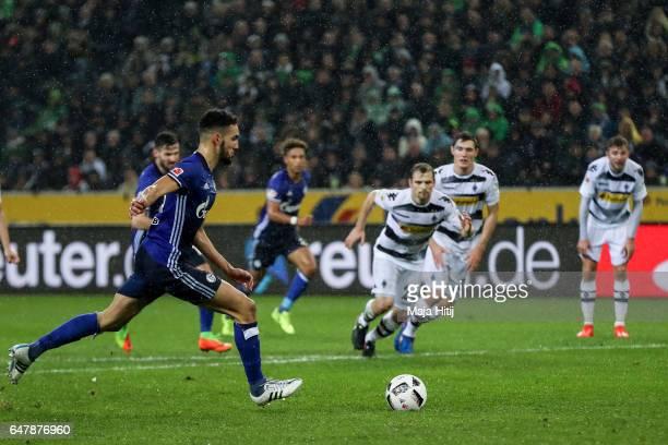 Nabil Bentaleb of Schalke scores 11meter penalty shot to make it 11 during the Bundesliga match between Borussia Moenchengladbach and FC Schalke 04...