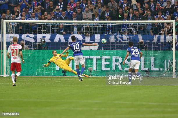 Nabil Bentaleb of Schalke scores from the penalty spot against Peter Gulacsi of Leipzig to make it 10 during the Bundesliga match between FC Schalke...