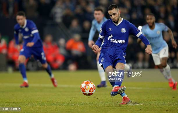 Nabil Bentaleb of Schalke scores the 2nd goal by penalty kick during the UEFA Champions League Round of 16 First Leg match between FC Schalke 04 and...
