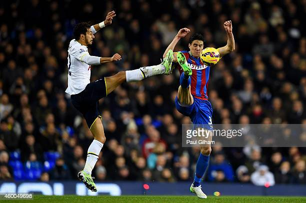 Nabil Bentaleb of Spurs battles for the ball with Martin Kelly of Crystal Palace during the Barclays Premier League match between Tottenham Hotspur...