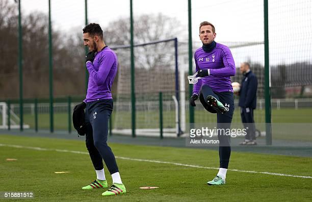 Nabil Bentaleb of Tottenham Hotspur and Harry Kane of Tottenham Hotspur warm up during a training session ahead of the UEFA Europa League Round of 16...