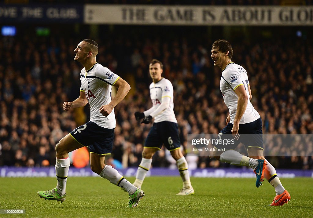 Nabil Bentaleb (L) of Tottenham Hotspur celebrates scoring the opening goal during the Capital One Cup Quarter-Final match between Tottenham Hotspur and Newcastle United at White Hart Lane on December 17, 2014 in London, England.