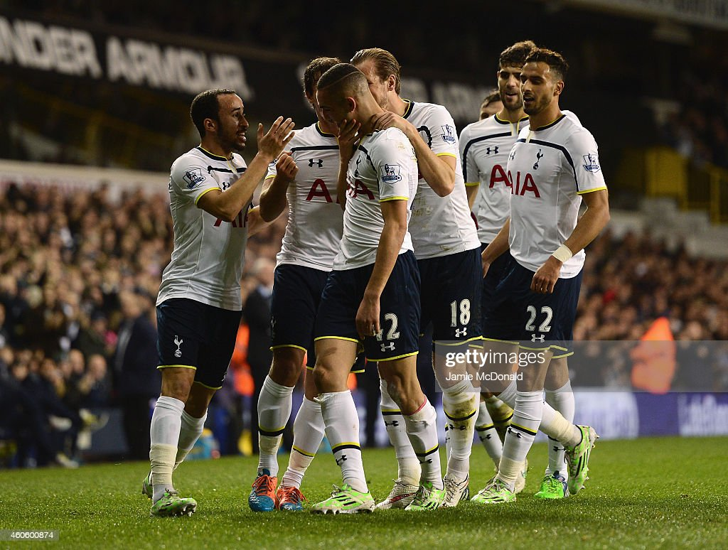 Nabil Bentaleb of Tottenham Hotspur celebrates scoring the opening goal with team mates during the Capital One Cup Quarter-Final match between Tottenham Hotspur and Newcastle United at White Hart Lane on December 17, 2014 in London, England.