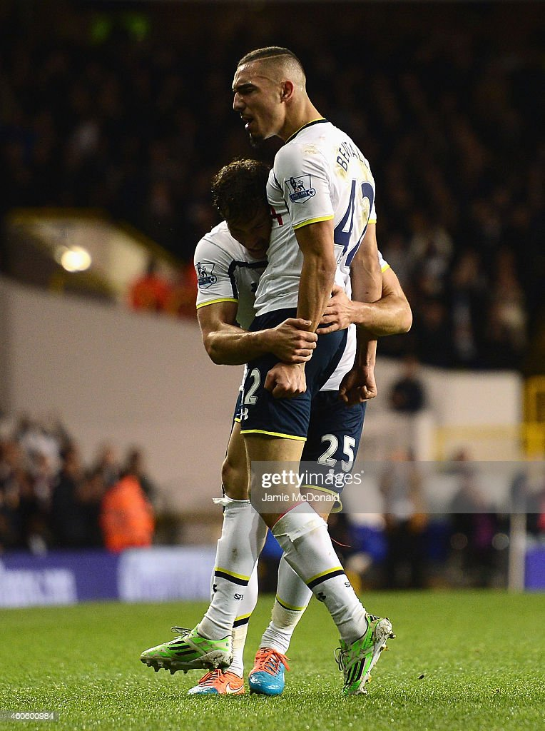 Nabil Bentaleb of Tottenham Hotspur celebrates scoring the opening goal with Benjamin Stambouli of Tottenham Hotspur during the Capital One Cup Quarter-Final match between Tottenham Hotspur and Newcastle United at White Hart Lane on December 17, 2014 in London, England.
