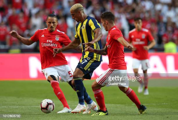 Nabil Dirar of Fenerbache SK tries to dribble Alex Grimaldo of and Ljubomir Fejsa of SL Benfica the UEFA Champions League Qualifier match between SL...