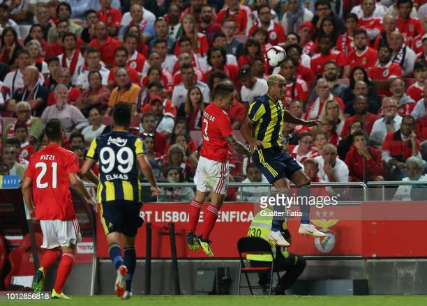 Nabil Dirar of Fenerbache SK with Alex Grimaldo of SL Benfica in action during the UEFA Champions League Qualifier match between SL Benfica and...