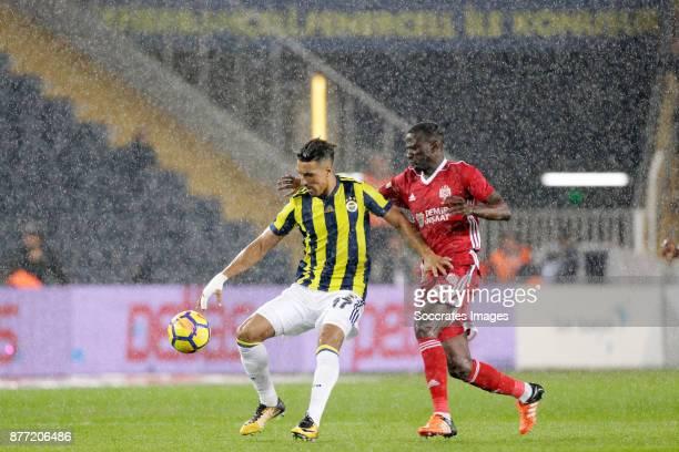 Nabil Dirar of Fenerbahce Delvin Ndinga of Sivasspor during the Turkish Super lig match between Fenerbahce v Sivasspor at the Sukru Saracoglustadion...