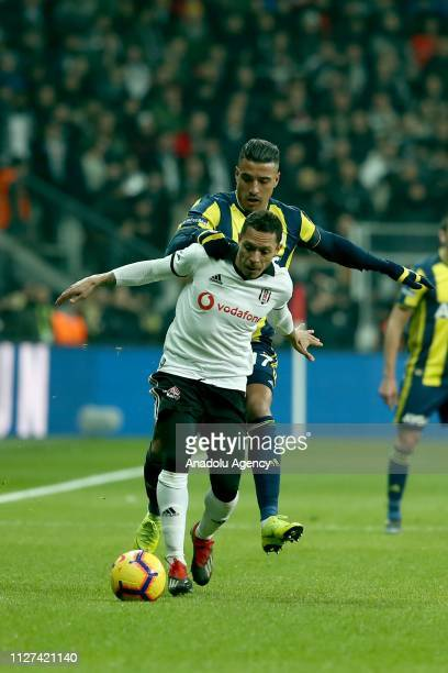 Nabil Dirar of Fenerbahce in action against Adriano Correia of Besiktas during Turkish Super Lig soccer match between Fenerbahce and Besiktas at...
