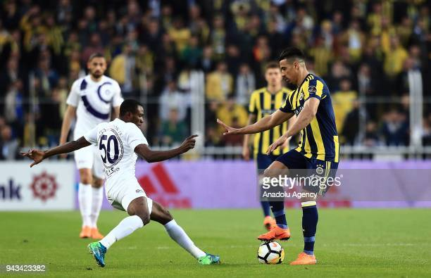 Nabil Dirar of Fenerbahce in action against Aminu Umar of Osmanlispor during the Turkish Super Lig football match between Fenerbahce and Osmanlispor...