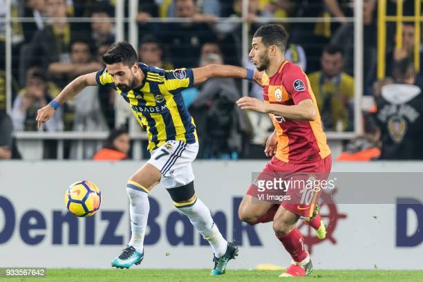 Nabil Dirar of Fenerbahce SK Younes Belhanda of Galatasaray SK during the Turkish Spor Toto Super Lig match Fenerbahce AS and Galatasaray AS at the...
