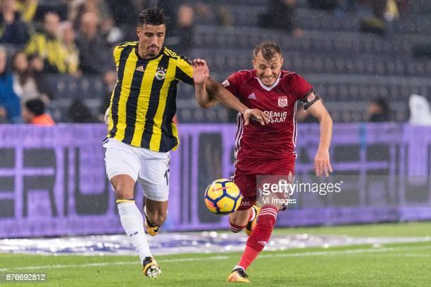 Nabil Dirar of Fenerbahce SK Ziya Erdal of Demir Grup Sivasspor during the Turkish Spor Toto Super Lig football match between Fenerbahce and Demir...