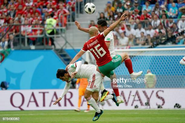 Nabil Dirar of Iran battles with Noureddine Amrabat of Morocco during the 2018 FIFA World Cup Russia group B match between Morocco and Iran at Saint...
