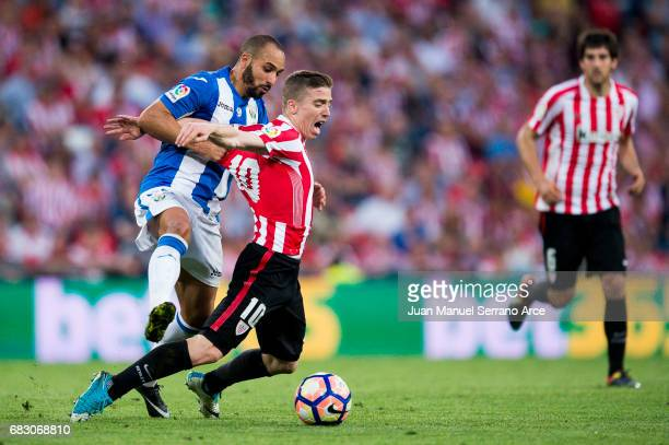 Nabil El Zhar of Club Deportivo Leganes competes for the ball with Iker Muniain of Athletic Club during the La Liga match between Athletic Club...