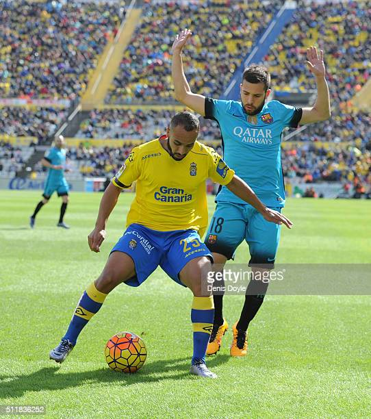 Nabil El Zhar of UD Las Palmas is challenged by Jordi Alba of FC Barcelona during the La Liga match between UD Las Palmas and FC Barcelona at Estadio...