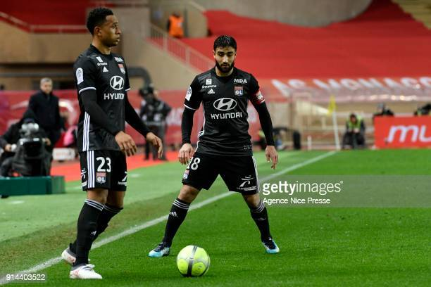 Nabil Fekir and Kenny Tete of Lyon during the Ligue 1 match between AS Monaco and Lyon at Stade Louis II on February 4 2018 in Monaco