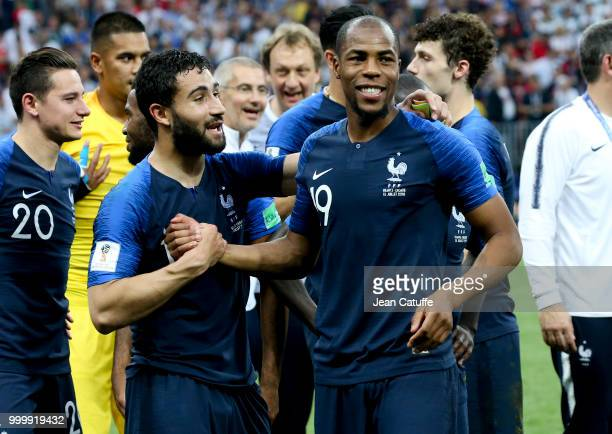 Nabil Fekir Djibril Sidibe of France celebrate the victory following the 2018 FIFA World Cup Russia Final between France and Croatia at Luzhniki...