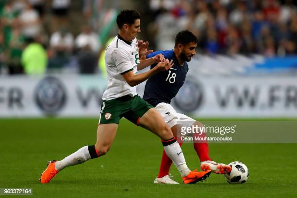 Nabil Fekir of France and Callum O'Dowda of Ireland battle for the ball during the International Friendly match between France and Ireland at Stade...
