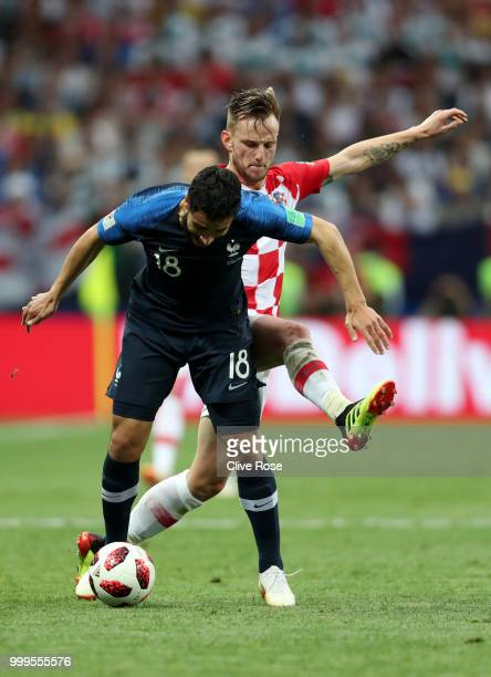Nabil Fekir of France and Ivan Rakitic of Croatia compete for the ball during the 2018 FIFA World Cup Final between France and Croatia at Luzhniki...