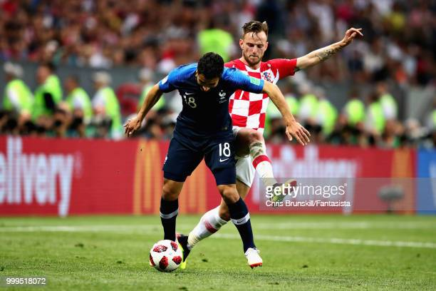 Nabil Fekir of France is challenged by Ivan Rakitic of Croatia during the 2018 FIFA World Cup Russia Final between France and Croatia at Luzhniki...