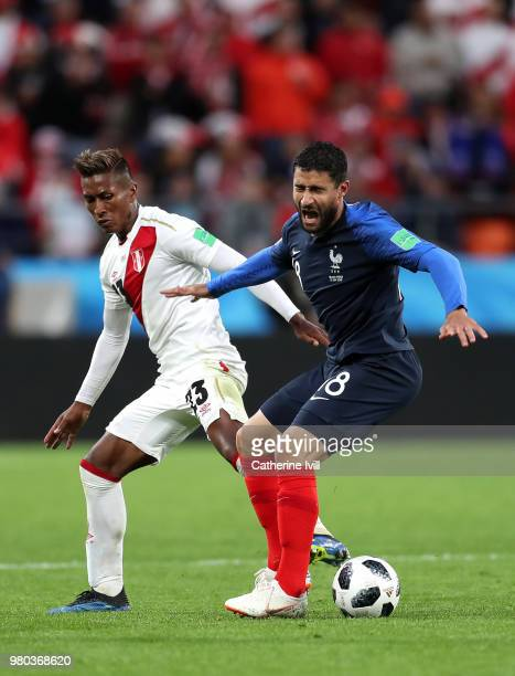 Nabil Fekir of France is challenged by Pedro Aquino of Peru during the 2018 FIFA World Cup Russia group C match between France and Peru at...