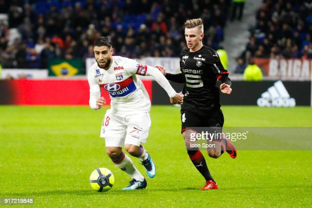Nabil Fekir of Lyon and Benjamin Bourigeaud of Rennes during the Ligue 1 match between Olympique Lyonnais and Stade Rennes at Parc Olympique on...