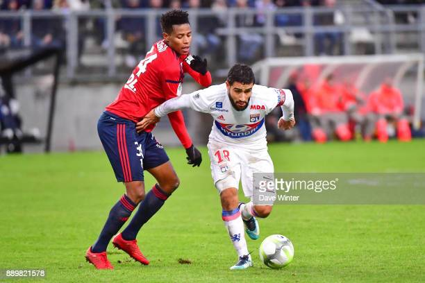 Nabil Fekir of Lyon and Bongani Zungu of Amiens during the Ligue 1 match between Amiens SC and Olympique Lyonnais at Stade de la Licorne on December...