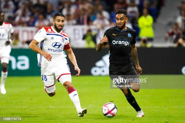 Nabil Fekir of Lyon and Jordan Amavi of Marseille during the Ligue 1 match between Lyon and Marseille at Parc Olympique on September 23 2018 in Lyon...