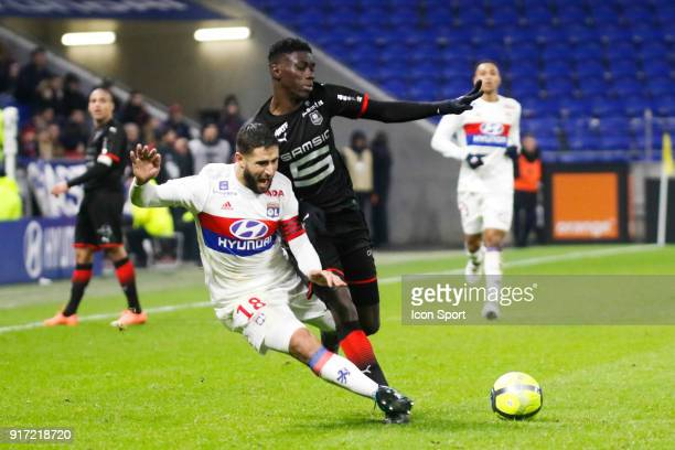 Nabil Fekir of Lyon and Joris Gnagnon of Rennes during the Ligue 1 match between Olympique Lyonnais and Stade Rennes at Parc Olympique on February 11...
