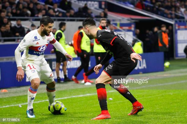 Nabil Fekir of Lyon and Rami Bensebaini of Rennes during the Ligue 1 match between Olympique Lyonnais and Stade Rennes at Parc Olympique on February...