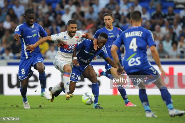 Nabil Fekir of Lyon and Yoann Salmier of Strasbourg during the Ligue 1 match between Olympique Lyonnais and Strasbourg at Parc Olympique on August 5...
