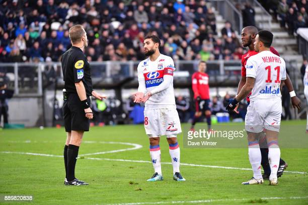 Nabil Fekir of Lyon argues a point with referee Olivier Thual during the Ligue 1 match between Amiens SC and Olympique Lyonnais at Stade de la...