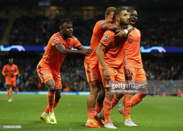 Nabil Fekir of Lyon celebrates after scoring his team's second goal with his team mates during the Group F match of the UEFA Champions League between...