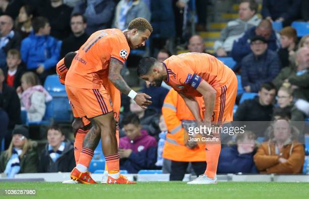 Nabil Fekir of Lyon celebrates his goal with Memphis Depay during the Group F match of the UEFA Champions League between Manchester City and...