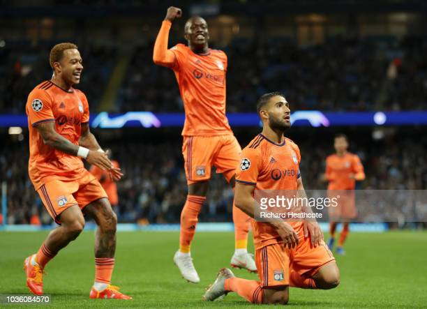 Nabil Fekir of Lyon celebrates with teammates after scoring his team's second goal during the Group F match of the UEFA Champions League between...