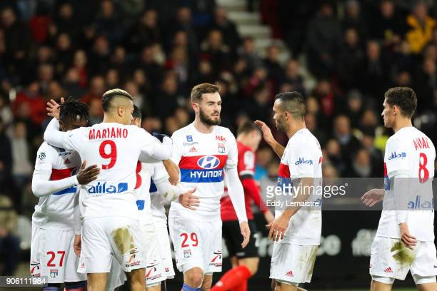 Nabil Fekir of Lyon celebrates with teammates and Lucas Tousart of Lyon after scoring a goal during the Ligue 1 match between EA Guingamp and...