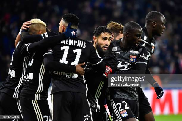Nabil Fekir of Lyon Ferland Mendy of Lyon and teammates celebrate a goal during the Ligue 1 match between Olympique Lyonnais and Lille OSC at Parc...