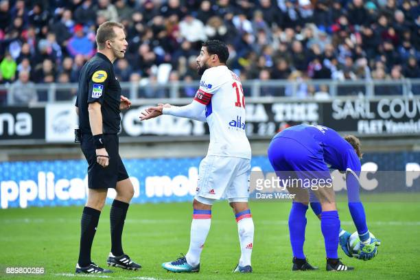 Nabil Fekir of Lyon has a discussion with referee Olivier Thual during the Ligue 1 match between Amiens SC and Olympique Lyonnais at Stade de la...